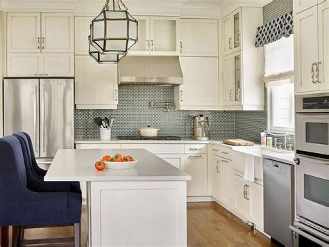 cream backsplash with white cabinets morris pendant transitional kitchen cameo homes