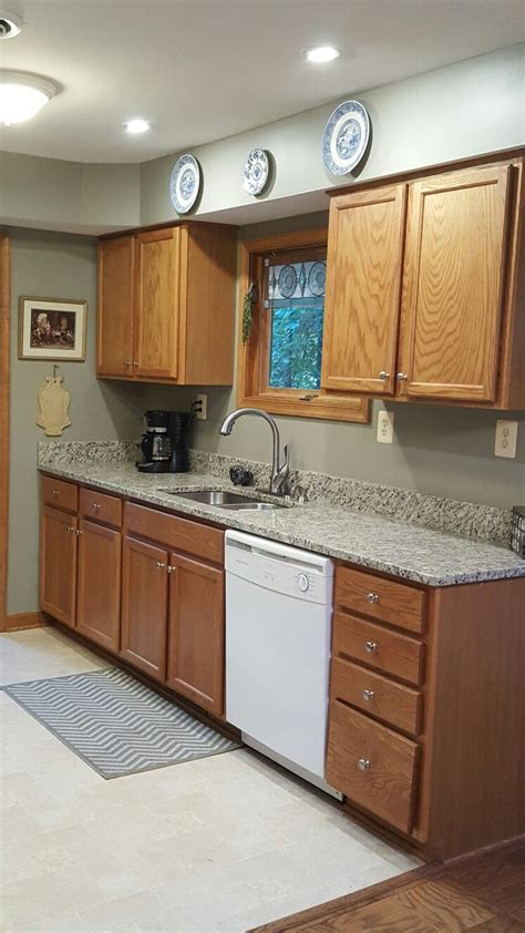gettysburg grey paint with blanco tulum granite against oak cabinets working flooring and