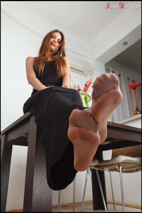 Sexy redhead with big soles