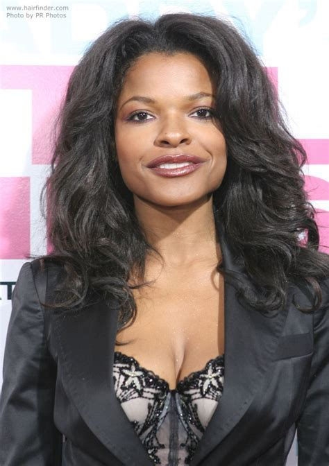 Keesha Sharp wearing her hair with a center part and lush