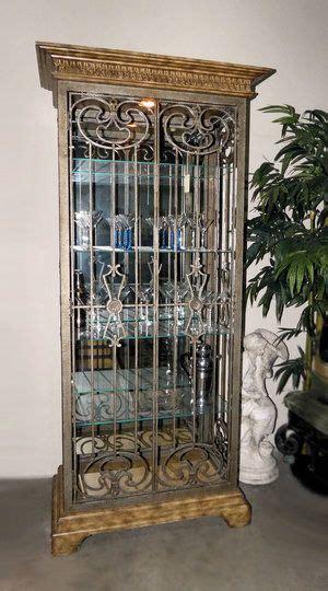 iron door lighted curio display cabinet iron doors