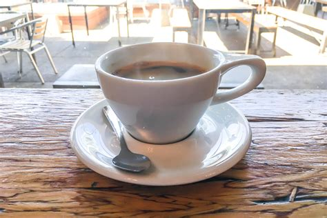 Our mission is to serve others, make a difference, and have fun. Free Stock Photo of White Coffee Cup On Wood Table