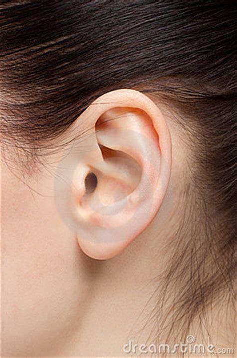 closeup   woman ear  black hair royalty  stock