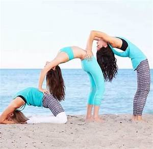 three person yoga bend into king pigeon pose. | Partner ...