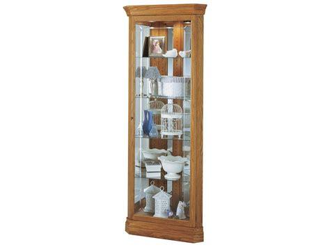 oak corner curio cabinet howard miller hammond golden oak corner curio cabinet 680347