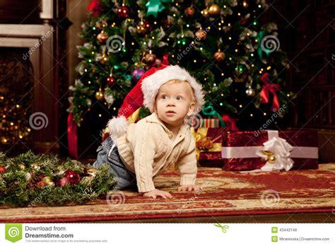 Baby Near The Christmas Tree. Little Boy Celebrati Stock