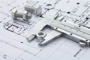 Vernier Calipers Measuring Metal Nut Stock Photo