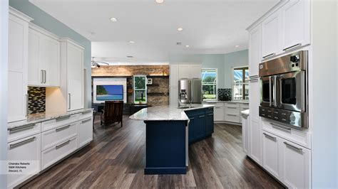 Off White Kitchen with Blue Island Cabinets   Omega