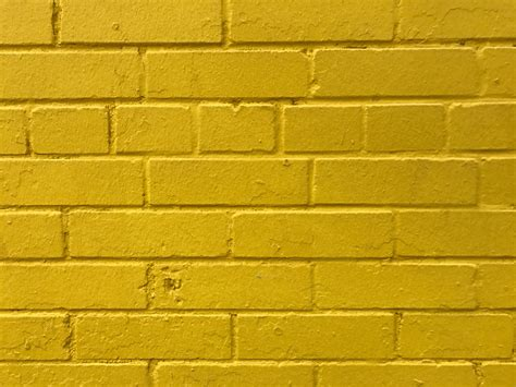 free photo yellow brick wall stones stonewall stained