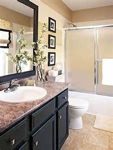 updating bathroom ideas done in a weekend bathroom refreshes vanities cabinets and striped walls