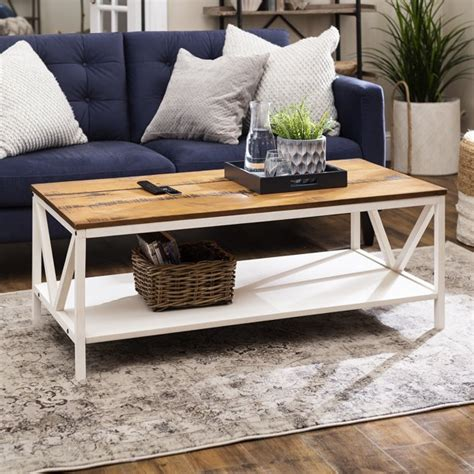 With a wood veneer tabletop, this particular coffee table will certainly be a great addition to your farmhouse. Farmhouse Reclaimed Barnwood Distressed Coffee Table by Manor Park - Walmart.com - Walmart.com