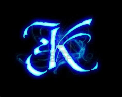 Blue Flame Magic Font Over Black Background. Letter K Stock Photo