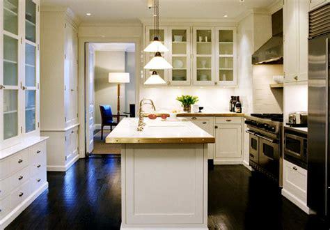 white kitchen cabinets  dark wood floors cottage
