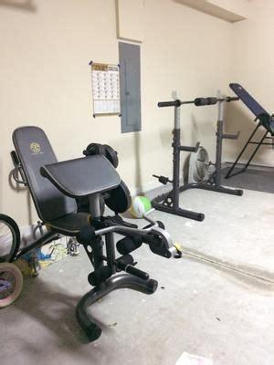 golds gym xrs  adjustable olympic workout bench  squat rack leg extension preacher curl
