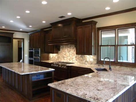 bianco antico granite with cabinets