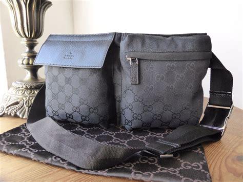 gucci belt bag  black gg monogram canvas sold