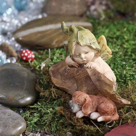 miniature sleeping fairy baby  puppy figurine whats