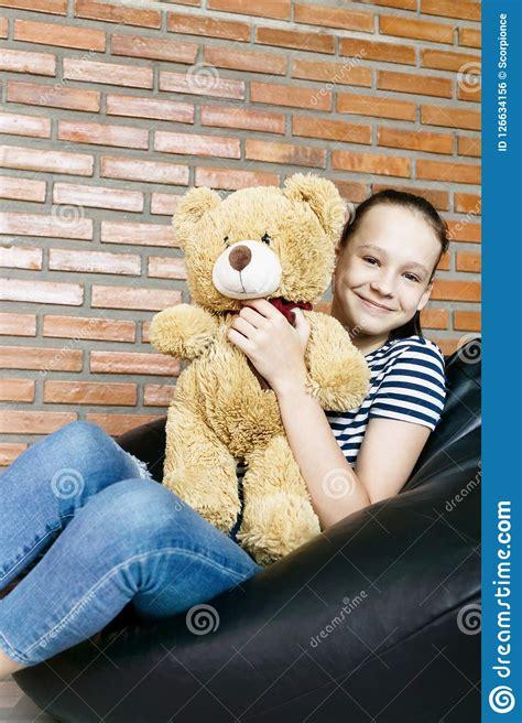 Beautiful Caucasian Teen Girl Sitting In Black Bean Bag