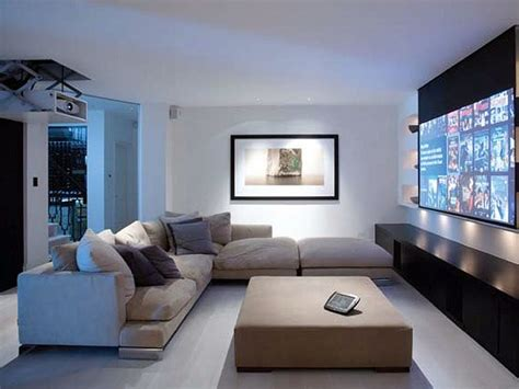 Fernseher Im Wohnzimmer by High Tech Im Wohnzimmer So Fallen Tv Beamer Und