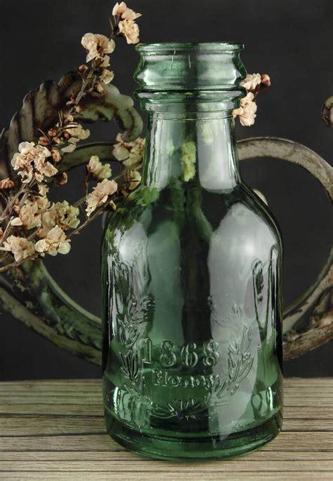 green glass honey bottle