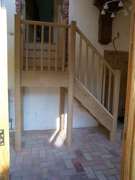 Oak stairs with half landing, stop chamfered newels and