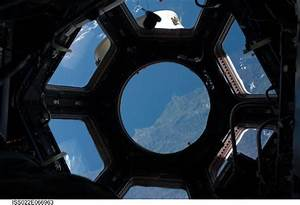 Nasa astronauts raise curtain on space station39s new view for Cupola windows