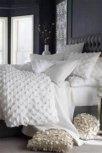 Add texture to an otherwise plain white bed with ruffled ...