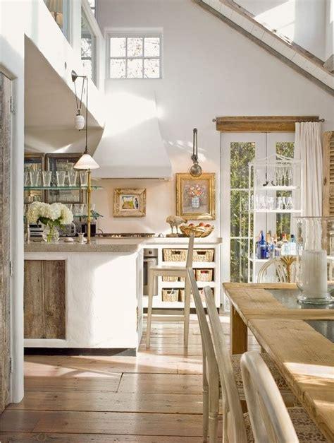 cottage kitchen  french doors exposed beam elmwood reclaimed grey barn wood paneling