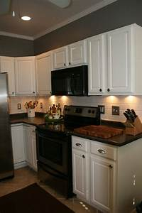best 25 kitchen black appliances ideas on pinterest With kitchen colors with white cabinets with rooms to go wall art