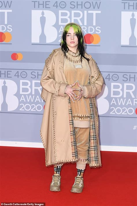 Billie Eilish is pictured WITHOUT trademark baggy clothes ...