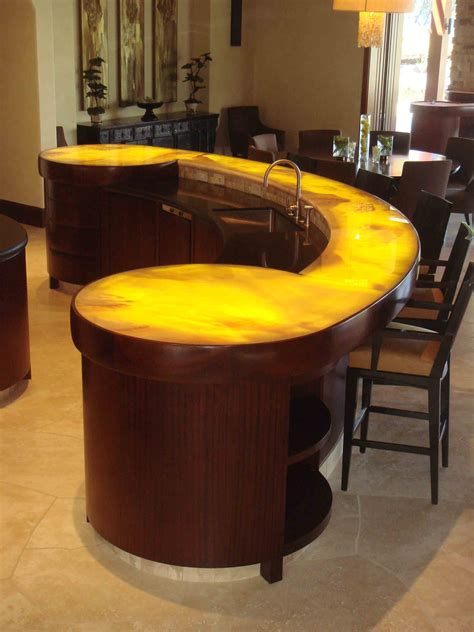 fabulous curved brown kitchen island with honed granite