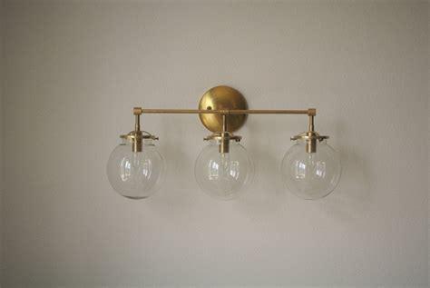 Globe Bathroom Light Fixtures by Glass Globe Brass Wall Sconce Bathroom By