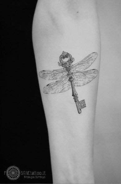 Skeleton key tattoo with dragonfly wings by Mindaugas Bumblys | Body Ink | Key tattoo designs