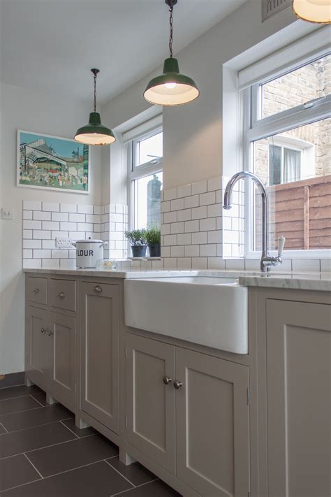 Trendy Pendant Lamps Over Cool White Single Farmhouse Sink