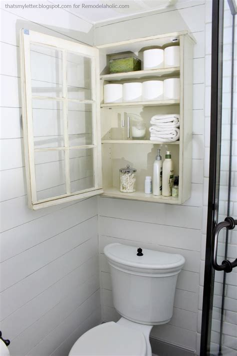 remodelaholic bathroom storage cabinet    window