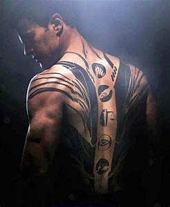 The symbols of each faction are on his back: Dauntless ...