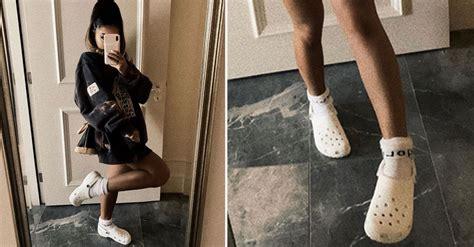 ariana grande posted  photo wearing crocs  socks
