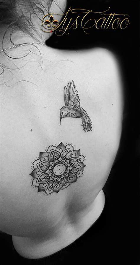 tatouage dos colonne vertebrale femme mandala floral