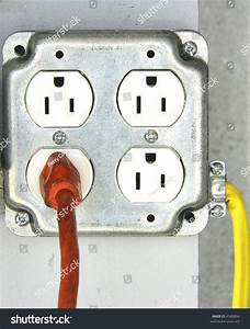 Interesting Detail Of Quad Outlet With One Orange Cord