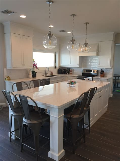 kitchen table islands white shaker waypoint cabinets designed by nathan hoffman
