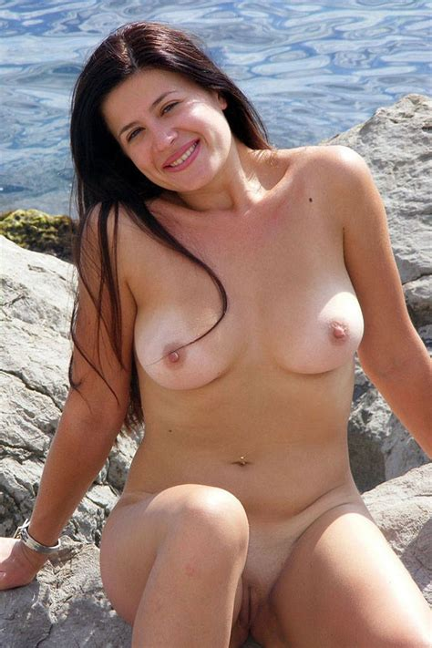 Amateur Brunette Milf Flashes Her Goods At Various Places