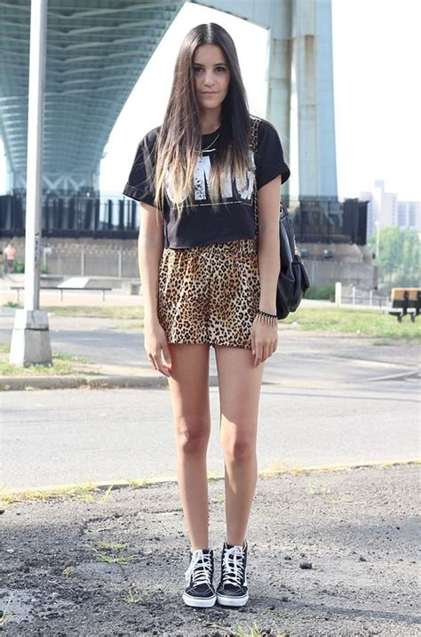 Picture Of animal print shorts and a printed tee with black Vans