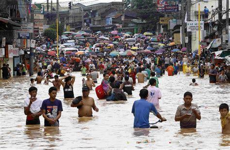 Philippine floods: Nineteen dead as rain continues ...