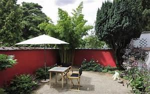 mur de la terrasse peint en rouge mon futur jardin With decaper un mur exterieur peint