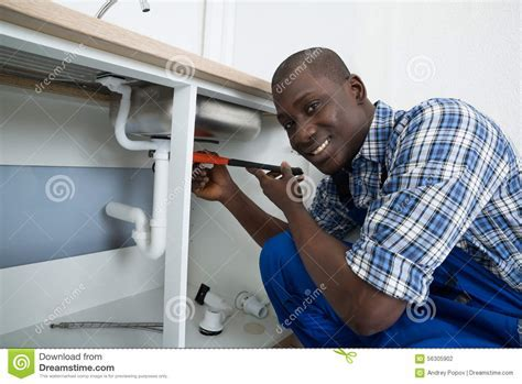 Male Plumber Fixing Pipe Of Sink Stock Photo   Image: 56305902
