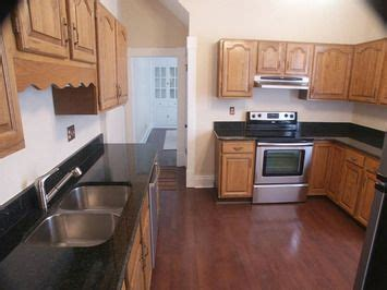 honey oak cabinets with dark wood floors google search dark or light wood floors table ideas