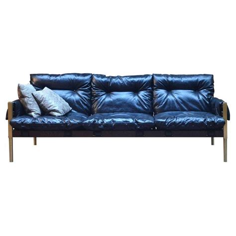 campanha sofa tufted leather brass legs wooden