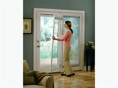 white enclosed blinds doors window blinds