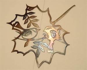 Two bird inside a leaf contour heat colored metal art