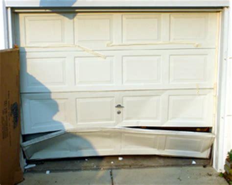 how to fix garage door panel easy garage door panel repair thats my house